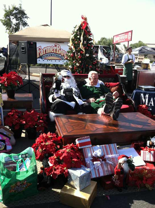 Garth the Elf hangs out with Santa Claus dressed in Raiders gear at the &#39;Spark of Love Toy Drive&#39; at Mathis Brothers in Ontario on Friday, Dec. 2, 2011. <span class=meta>(KABC Photo)</span>