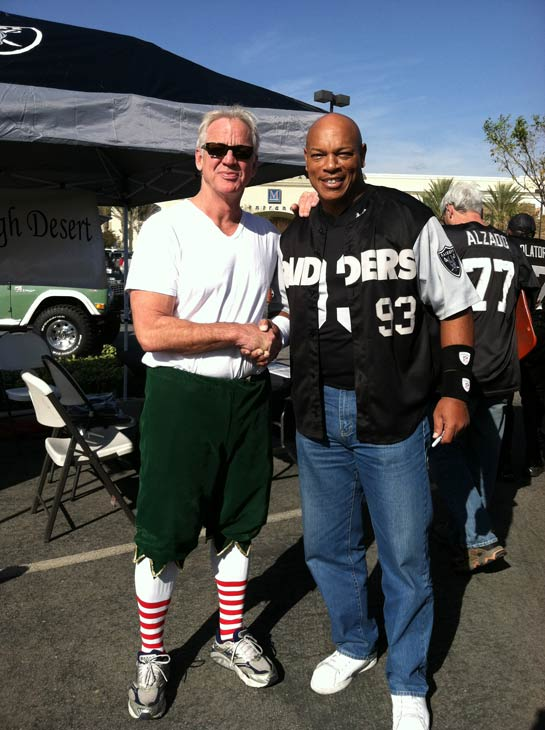 Garth the Elf poses with former LA Raiders football player Greg Townsend at the &#39;Spark of Love Toy Drive&#39; at Mathis Brothers in Ontario on Friday, Dec. 2, 2011. <span class=meta>(KABC Photo)</span>