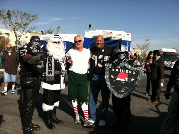Garth the Elf poses with former LA Raiders football player Greg Townsend and two other Raiders fans at the &#39;Spark of Love Toy Drive&#39; at Mathis Brothers in Ontario on Friday, Dec. 2, 2011. <span class=meta>(KABC Photo)</span>