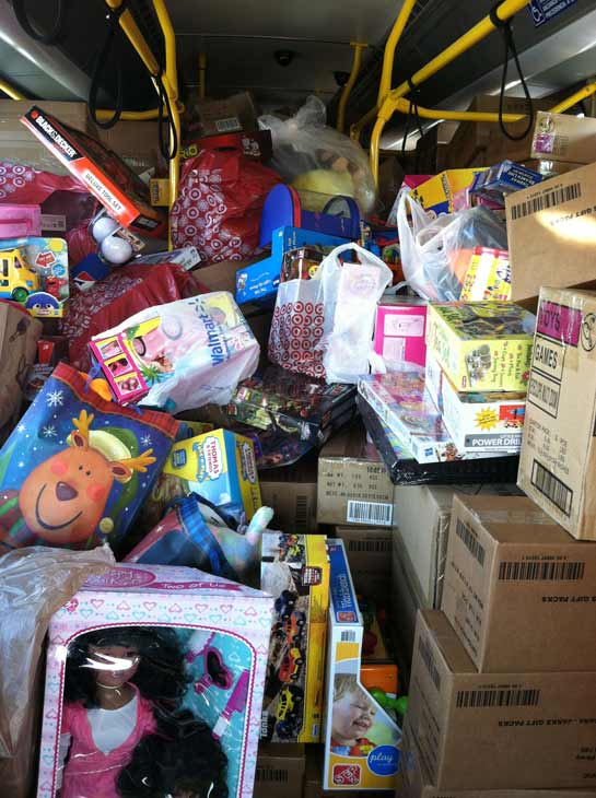 "<div class=""meta ""><span class=""caption-text "">The fourth bus is stuffed at the 'Spark of Love Toy Drive' at Mathis Brothers in Ontario on Friday, Dec. 2, 2011. (KABC Photo)</span></div>"