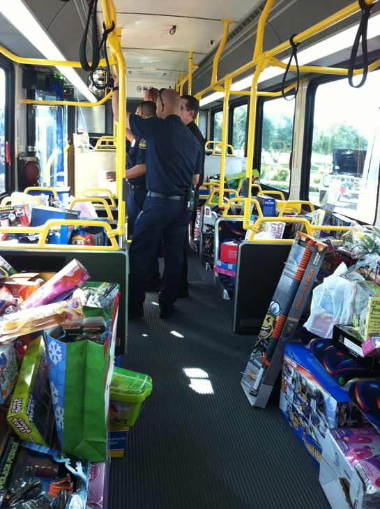 The fifth bus starts filling up at the &#39;Spark of Love Toy Drive&#39; at Mathis Brothers in Ontario on Friday, Dec. 2, 2011. <span class=meta>(KABC Photo)</span>