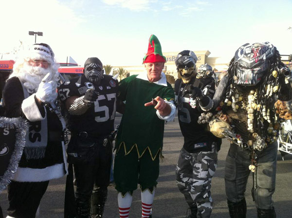 Garth the Elf poses with Raiders fans at the &#39;Spark of Love Toy Drive&#39; at Mathis Brothers in Ontario on Friday, Dec. 2, 2011. <span class=meta>(KABC Photo)</span>
