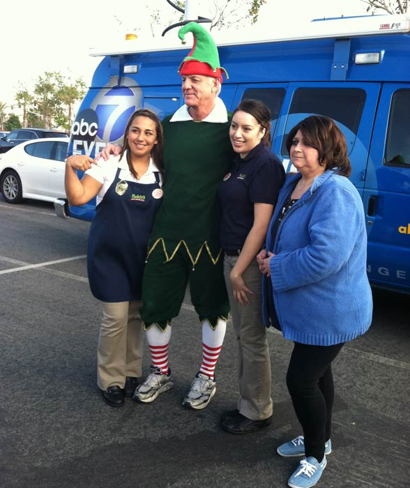 Garth the Elf poses with the Rubio&#39;s crew at the &#39;Spark of Love Toy Drive&#39; at Mathis Brothers in Ontario on Friday, Dec. 2, 2011. <span class=meta>(KABC Photo)</span>