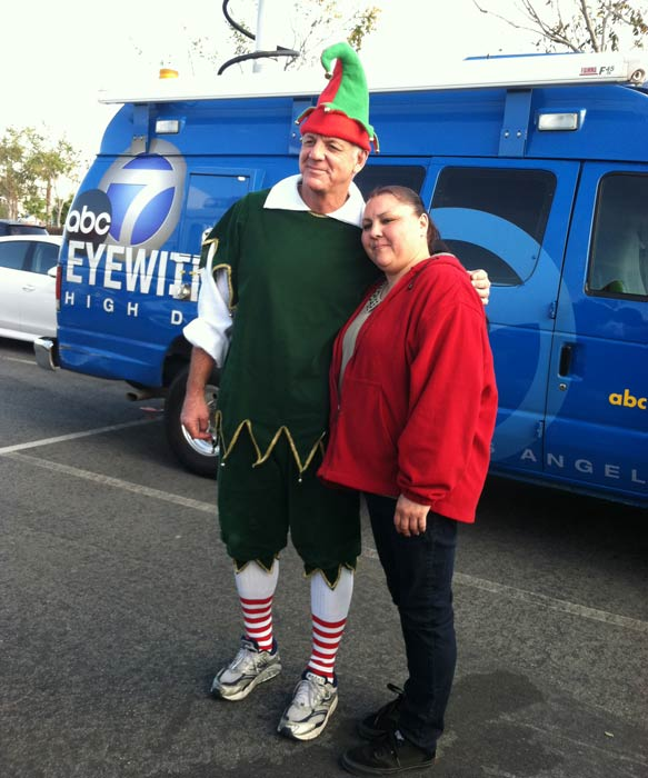 "<div class=""meta ""><span class=""caption-text "">Garth the Elf poses with a local resident at the 'Spark of Love Toy Drive' at Mathis Brothers in Ontario on Friday, Dec. 2, 2011. (KABC Photo)</span></div>"
