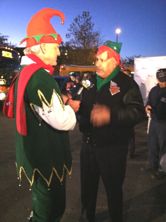 "<div class=""meta ""><span class=""caption-text "">Garth the Elf talks to L.A. Councilman Dennis Zine at the 'Spark of Love Toy Drive' at Westfield Topanga Mall in Canoga Park on Friday, Dec. 9, 2011. (KABC Photo)</span></div>"