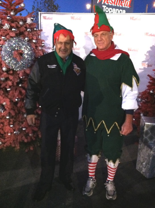 "<div class=""meta ""><span class=""caption-text "">Garth the Elf poses with L.A. Councilman Dennis Zine at the 'Spark of Love Toy Drive' at Westfield Topanga Mall in Canoga Park on Friday, Dec. 9, 2011. (KABC Photo)</span></div>"