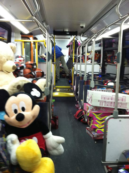 "<div class=""meta ""><span class=""caption-text "">First bus starts getting filled with toys at the 'Spark of Love Toy Drive' at Westfield Topanga Mall in Canoga Park on Friday, Dec. 9, 2011. (KABC Photo)</span></div>"