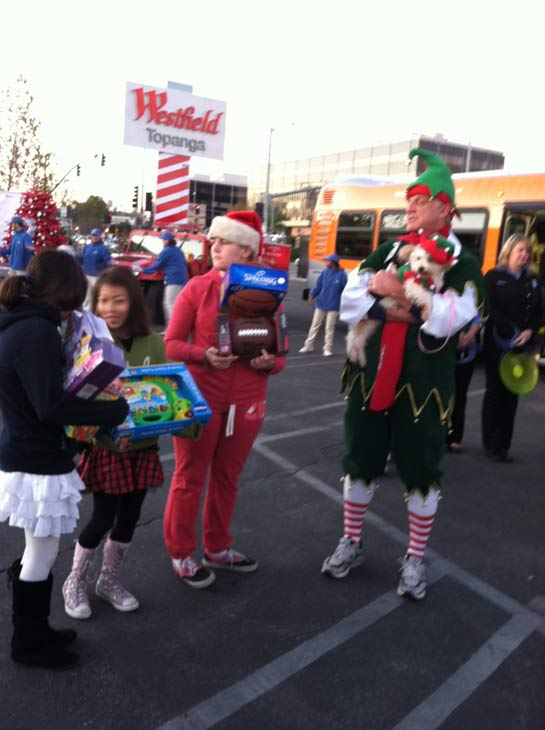 "<div class=""meta ""><span class=""caption-text "">Garth the Elf stands with students waiting to donate toys at the 'Spark of Love Toy Drive' at Westfield Topanga Mall in Canoga Park on Friday, Dec. 9, 2011. (KABC Photo)</span></div>"