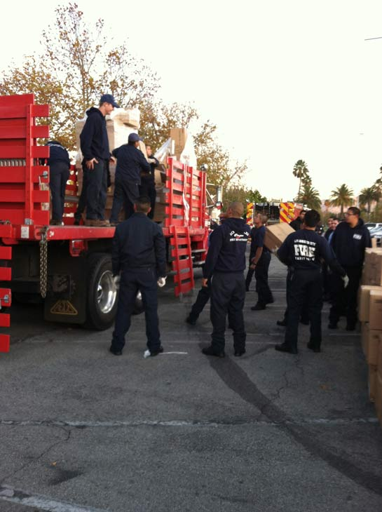 "<div class=""meta ""><span class=""caption-text "">Los Angeles City firefighters help unload toys at the 'Spark of Love Toy Drive' at Westfield Topanga Mall in Canoga Park on Friday, Dec. 9, 2011. (KABC Photo)</span></div>"