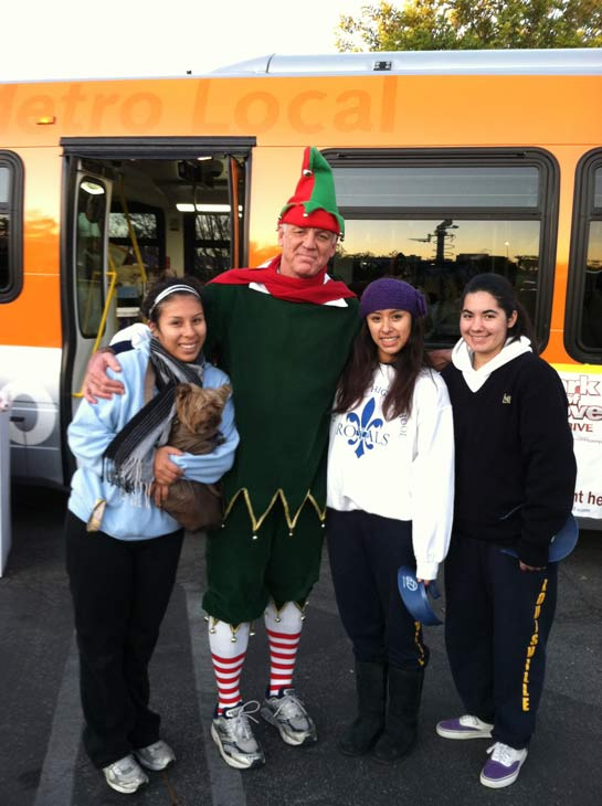 Garth the Elf poses with residents from the Reseda area at the &#39;Spark of Love Toy Drive&#39; at Westfield Topanga Mall in Canoga Park on Friday, Dec. 9, 2011. <span class=meta>(KABC Photo)</span>