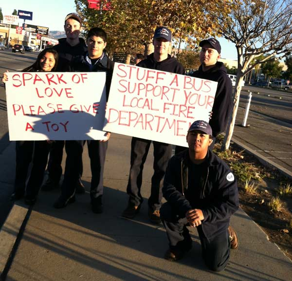 L.A. City Fire cadets help out at the &#39;Spark of Love Toy Drive&#39; at Westfield Topanga Mall in Canoga Park on Friday, Dec. 9, 2011. <span class=meta>(KABC Photo)</span>