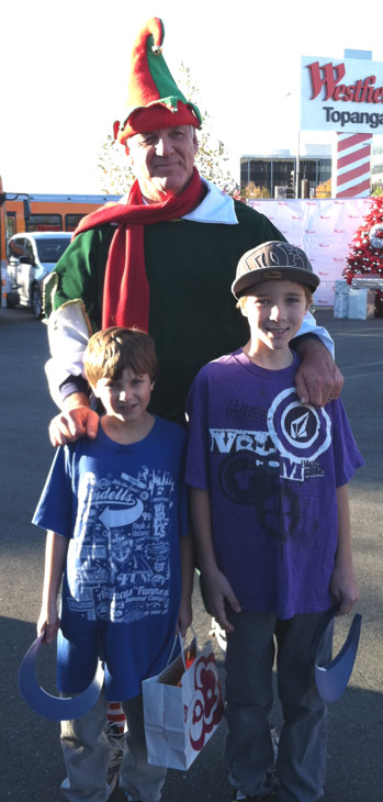 Garth the Elf poses with Kyle and Aaron at the &#39;Spark of Love Toy Drive&#39; at Westfield Topanga Mall in Canoga Park on Friday, Dec. 9, 2011. <span class=meta>(KABC Photo)</span>