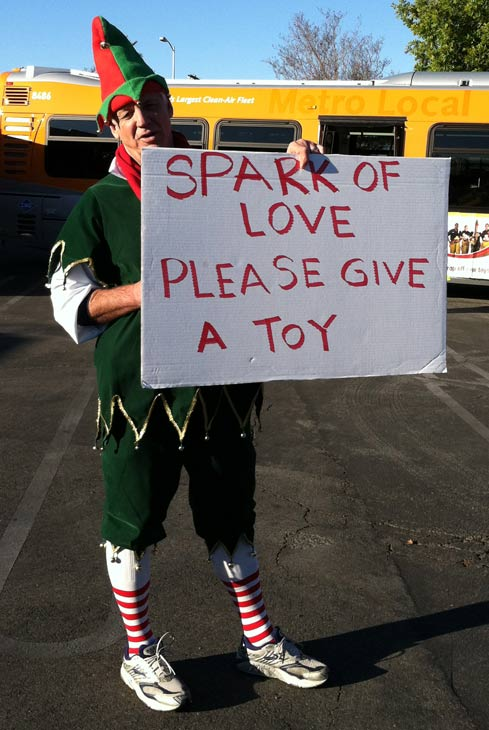"<div class=""meta ""><span class=""caption-text "">Garth the Elf holds up a sign at the 'Spark of Love Toy Drive' at Westfield Topanga Mall in Canoga Park on Friday, Dec. 9, 2011. (KABC Photo)</span></div>"