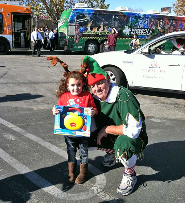 Garth the Elf and Brooklyn at the &#39;Spark of Love Toy Drive&#39; Stuff-A-Bus event at Westfield Topanga Mall in Canoga Park on Friday, Dec. 9, 2011. <span class=meta>(KABC Photo)</span>