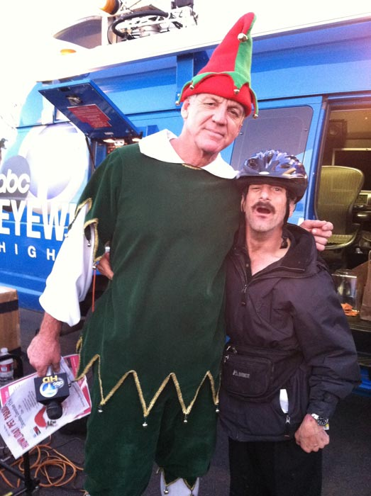 Garth the Elf and Glenn at the &#39;Spark of Love Toy Drive&#39; Stuff-A-Bus event at Westfield Topanga Mall in Canoga Park on Friday, Dec. 9, 2011. <span class=meta>(KABC Photo)</span>