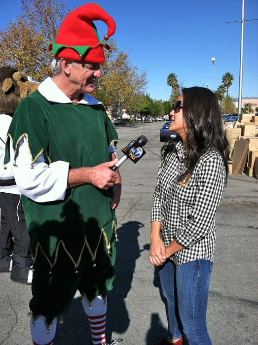 Garth the Elf talks with Anne-Marie Feliciano of JAKKS Pacific at the &#39;Spark of Love Toy Drive&#39; Stuff-A-Bus event at Westfield Topanga Mall in Canoga Park on Friday, Dec. 9, 2011. <span class=meta>(KABC Photo)</span>