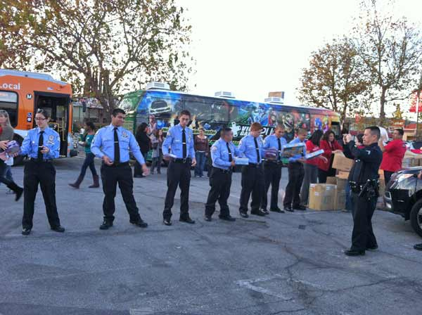 LAPD cadets are hard at work at the &#39;Spark of Love Toy Drive&#39; Stuff-A-Bus event at Westfield Topanga Mall in Canoga Park on Friday, Dec. 9, 2011. <span class=meta>(KABC Photo)</span>