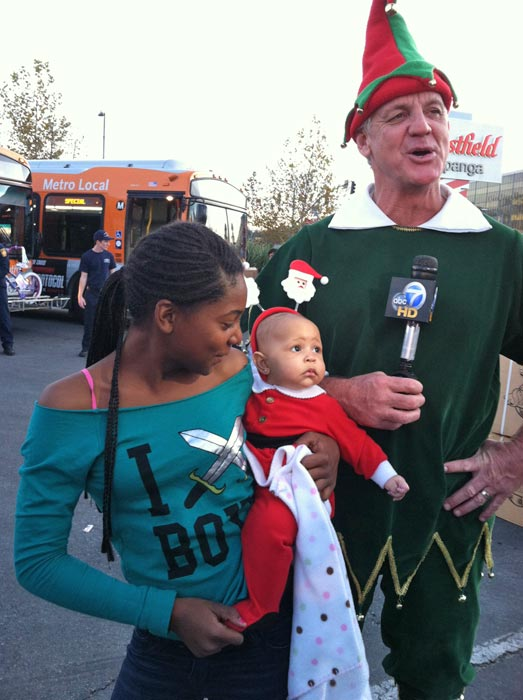 Garth the Elf poses with local residents at the &#39;Spark of Love Toy Drive&#39; Stuff-A-Bus event at Westfield Topanga Mall in Canoga Park on Friday, Dec. 9, 2011. <span class=meta>(KABC Photo)</span>