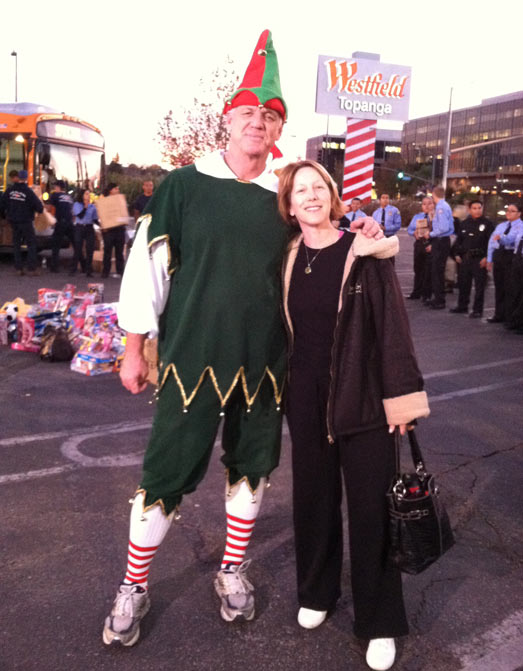 "<div class=""meta ""><span class=""caption-text "">Garth the Elf with a local resident at the 'Spark of Love Toy Drive' Stuff-A-Bus event at Westfield Topanga Mall in Canoga Park on Friday, Dec. 9, 2011. (KABC Photo)</span></div>"
