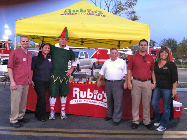 Garth the Elf with the Rubio&#39;s crew at the &#39;Spark of Love Toy Drive&#39; Stuff-A-Bus event at Westfield Topanga Mall in Canoga Park on Friday, Dec. 9, 2011. <span class=meta>(KABC Photo)</span>