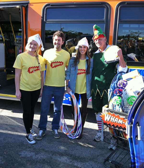 "<div class=""meta ""><span class=""caption-text "">Wham-O team members pose with Garth the Elf at the 'Spark of Love Toy Drive' Stuff-A-Bus event at Westfield Topanga Mall in Canoga Park on Friday, Dec. 9, 2011. (KABC Photo)</span></div>"