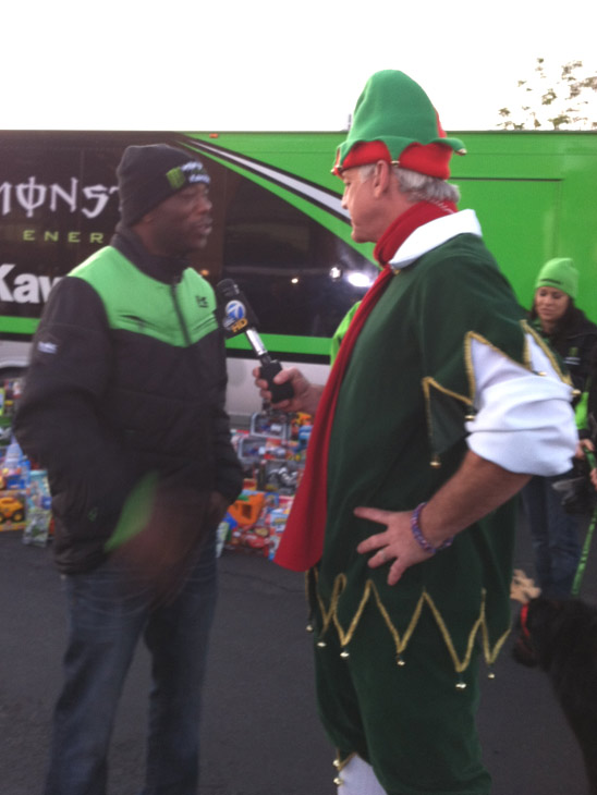 Garth the Elf talks to a Kawasaki representative at the Stuff-A-Bus event at the Honda Center in Anaheim on Friday, Dec. 16, 2011. <span class=meta>(KABC Photo)</span>