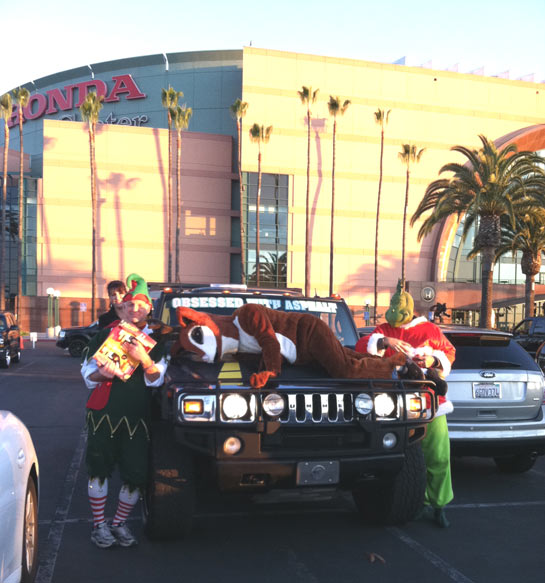 Garth the Elf poses with other holiday characters at the Stuff-A-Bus event at the Honda Center in Anaheim on Friday, Dec. 16, 2011. <span class=meta>(KABC Photo)</span>