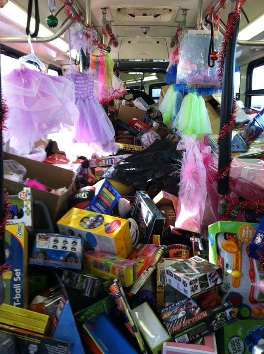 The second bus is stuffed at the Stuff-A-Bus event at the Honda Center in Anaheim on Friday, Dec. 16, 2011.