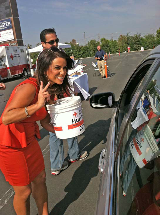 ABC7 Eyewitness News traffic reporter Alysha Del Valle collects a check donation from a viewer at our Sandy relief drive at the Honda Center in Anaheim on Thursday, Nov. 1, 2012.  <span class=meta>(KABC)</span>