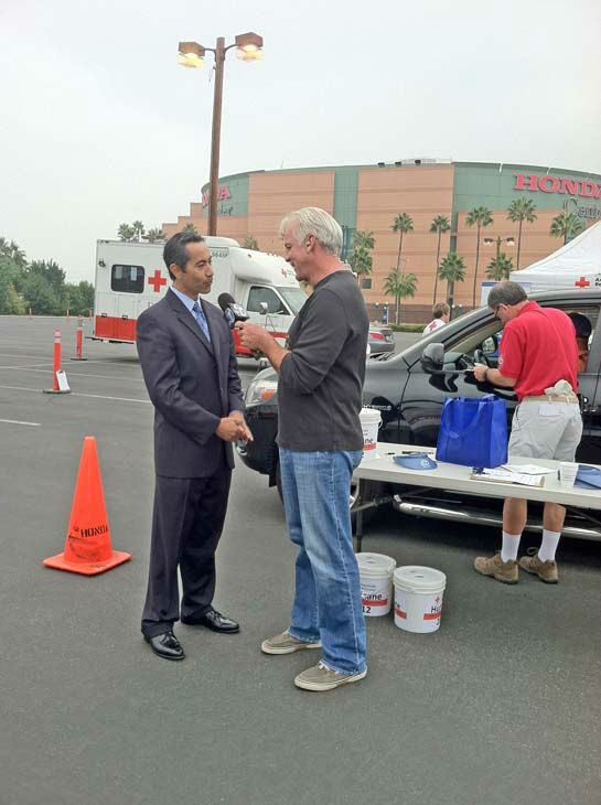 ABC7 Eyewitness News weathercaster Garth Kemp interviews Wells Fargo Orange County Community Bank President Ben Alvarado at our Sandy relief drive at the Honda Center in Anaheim on Thursday, Nov. 1, 2012. <span class=meta>(KABC)</span>