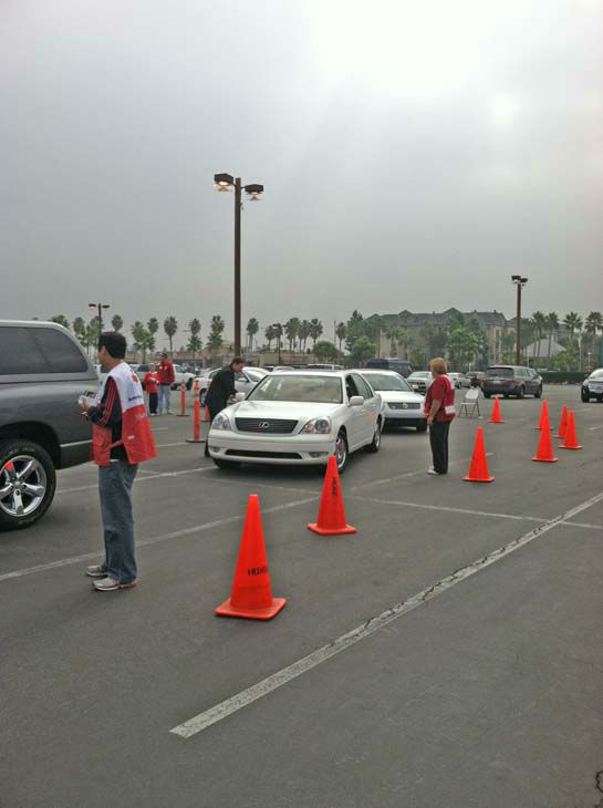 American Red Cross volunteers and ABC7 Eyewitness News consumer specialist Ric Romero collect donations from viewers at our Sandy relief drive at the Honda Center in Anaheim on Thursday, Nov. 1, 2012. <span class=meta>(KABC Photo)</span>