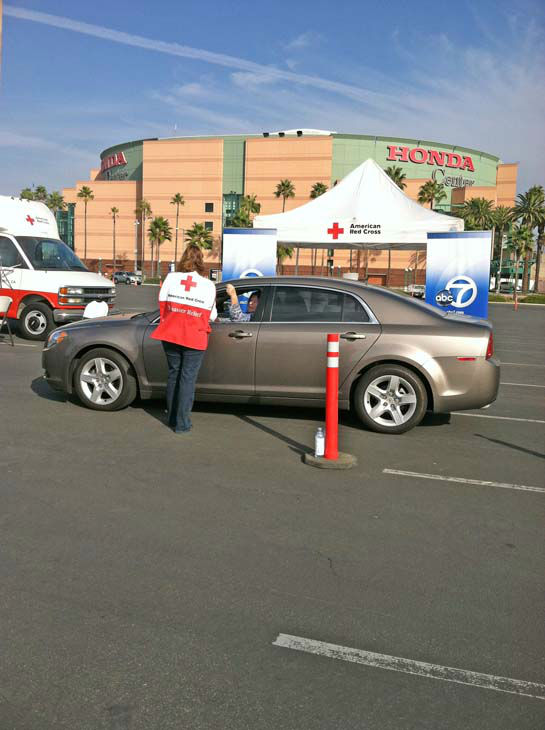 An American Red Cross volunteer collects a donation from an ABC7 viewer at our Sandy relief drive at the Honda Center in Anaheim on Thursday, Nov. 1, 2012. <span class=meta>(KABC)</span>
