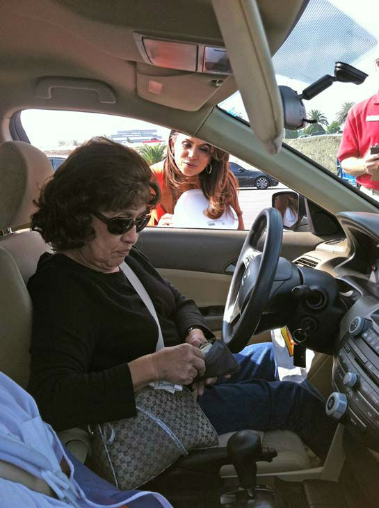ABC7 Eyewitness News traffic reporter Alysha Del Valle collects a cash donation from a viewer at our Sandy relief drive at the Honda Center in Anaheim on Thursday, Nov. 1, 2012. <span class=meta>(KABC)</span>
