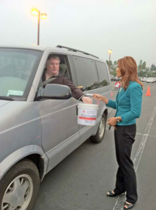"<div class=""meta ""><span class=""caption-text "">ABC7 Eyewitness News Orange County bureau chief Eileen Frere collects a donation from a viewer at our Sandy relief drive at the Honda Center in Anaheim on Thursday, Nov. 1, 2012. (KABC)</span></div>"