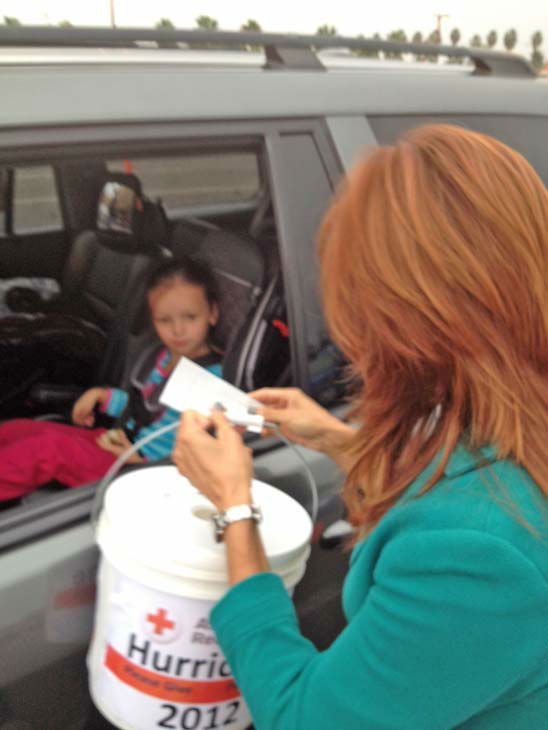 ABC7 Eyewitness News Orange County bureau chief Eileen Frere collects a donation from a viewer at our Sandy relief drive at the Honda Center in Anaheim on Thursday, Nov. 1, 2012. <span class=meta>(KABC)</span>