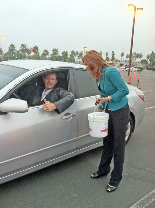 ABC7 Eyewitness News Orange County bureau chief Eileen Frere collects a donation from a viewer at our Sandy relief drive at the Honda Center in Anaheim on Thursday, Nov. 1, 2012. <span class=meta>(KABC Photo)</span>