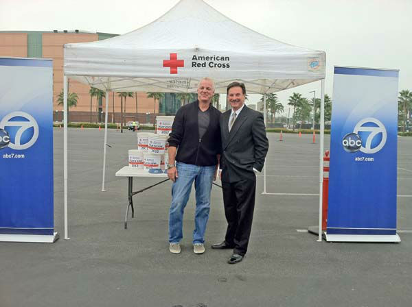 ABC7 Eyewitness News weathercaster Garth Kemp and consumer specialist Ric Romero at the ABC7 Sandy relief drive at the Honda Center in Anaheim on Thursday, Nov. 1, 2012. <span class=meta>(KABC)</span>