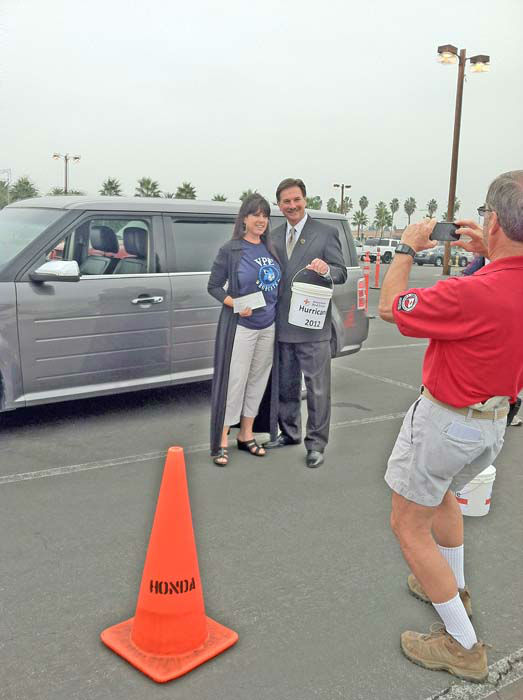 ABC7 Eyewitness News consumer specialist Ric Romero and a generous viewer pose for a picture at the ABC7 Sandy relief drive at the Honda Center in Anaheim on Thursday, Nov. 1, 2012. <span class=meta>(KABC)</span>