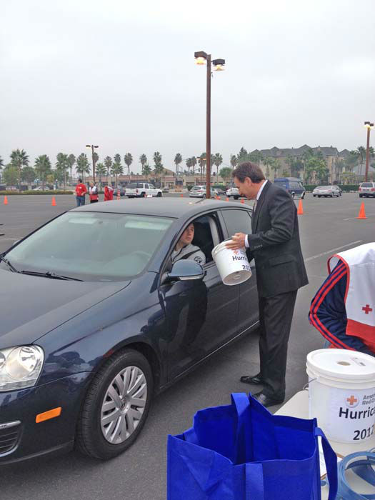 ABC7 Eyewitness News consumer specialist Ric Romero collects a donation from an ABC7 viewer who came out to support our East Coast neighbors devastated by Superstorm Sandy at the Honda Center in Anaheim on Thursday, Nov. 1, 2012. <span class=meta>(KABC)</span>
