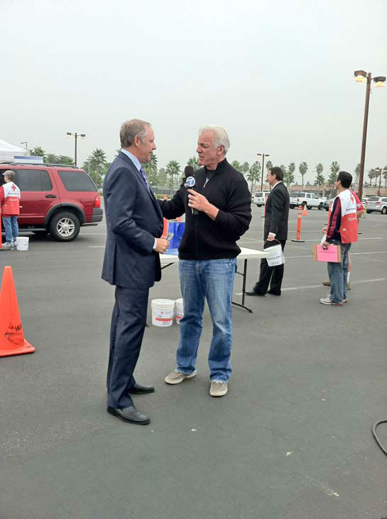 ABC7 Eyewitness News weathercaster Garth Kemp interviews Honda Center CEO and Anaheim Ducks COO Tim Ryan at the ABC7 Sandy relief drive at the Honda Center in Anaheim on Thursday, Nov. 1, 2012.  The Honda Center donated &#36;10,000. <span class=meta>(KABC)</span>