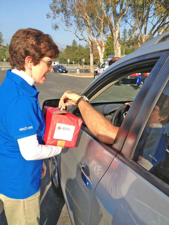 ABC7 Eyewitness News reporter Adrienne Alpert collects a donation from an ABC7 viewer who came out to support our East Coast neighbors devastated by Superstorm Sandy at the Rose Bowl in Pasadena on Friday, Nov. 2, 2012.  <span class=meta>(KABC)</span>