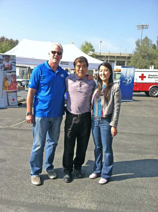 ABC7 Eyewitness News weathercaster Garth Kemp poses with viewers at the Sandy relief drive at the Rose Bowl in Pasadena on Friday, Nov. 2, 2012. <span class=meta>(KABC)</span>