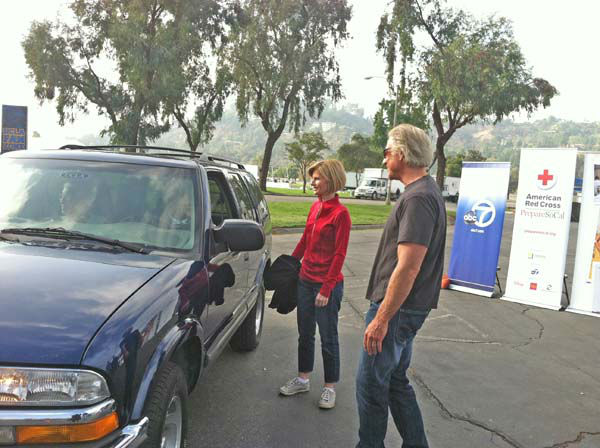 ABC7 Eyewitness News chief meteorologist Dallas Raines and anchor Michelle Tuzee collect donations from ABC7 viewers at our Sandy relief drive at the Rose Bowl in Pasadena on Friday, Nov. 2, 2012. <span class=meta>(KABC)</span>