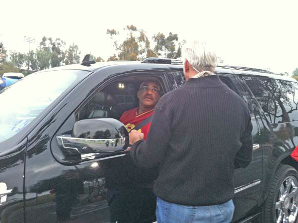 ABC7 Eyewitness News weathercaster Garth Kemp collects a donation from a viewer at our Sandy relief drive at the Rose Bowl in Pasadena on Friday, Nov. 2, 2012. <span class=meta>(KABC)</span>