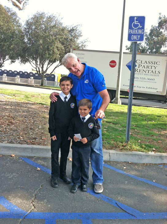 ABC7 Eyewitness News weathercaster Garth Kemp poses with two young viewers at the Sandy relief drive at the Rose Bowl in Pasadena on Friday, Nov. 2, 2012.