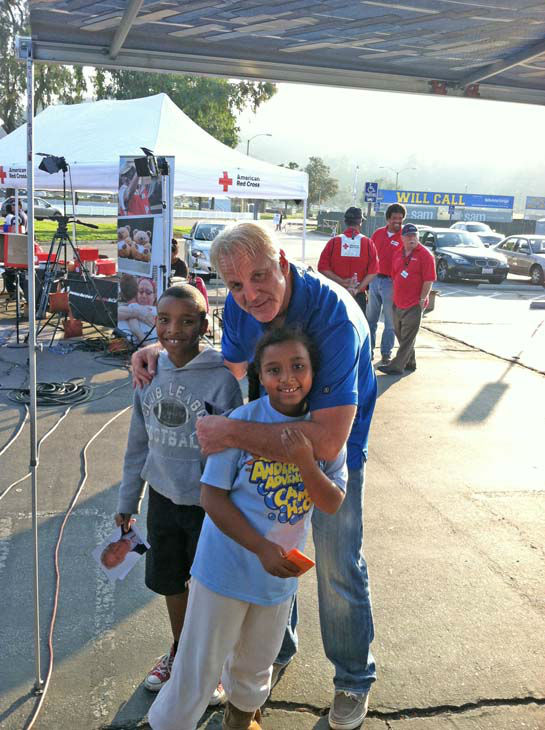 ABC7 Eyewitness News weathercaster Garth Kemp poses with two young viewers at our Sandy Relief Drive at the Rose Bowl in Pasadena on Friday, Nov. 2, 2012.  <span class=meta>(KABC)</span>