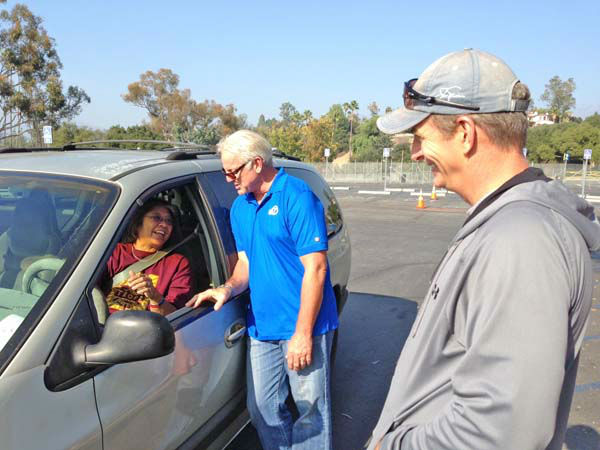 ABC7 Eyewitness News weathercaster Garth Kemp and ABC7 anchor Phillip Palmer collect a donation from a generous viewer at our Sandy relief drive at the Rose Bowl in Pasadena on Friday, Nov. 2, 2012. <span class=meta>(KABC)</span>