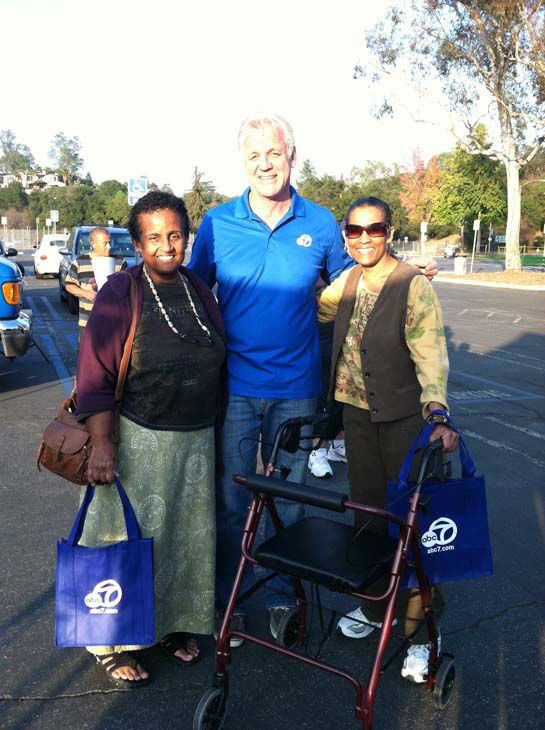 ABC7 Eyewitness News weathercaster Garth Kemp poses with viewers at our Sandy relief drive at the Rose Bowl in Pasadena on Friday, Nov. 2, 2012.