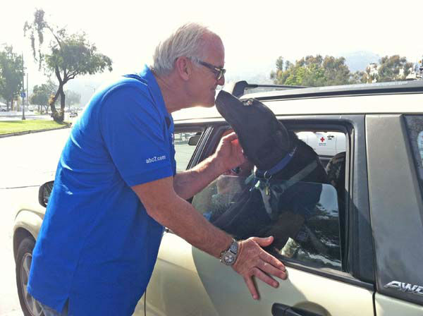 ABC7 Eyewitness News weathercaster Garth Kemp gets a kiss from a loving dog and a donation from its owner at our Sandy relief drive at the Rose Bowl in Pasadena on Friday, Nov. 2, 2012. <span class=meta>(KABC)</span>