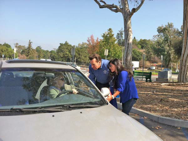 ABC7 Eyewitness News car specialist Dave Kunz collects a donation from a viewer at our Sandy relief drive at the Rose Bowl in Pasadena on Friday, Nov. 2, 2012. <span class=meta>(KABC)</span>